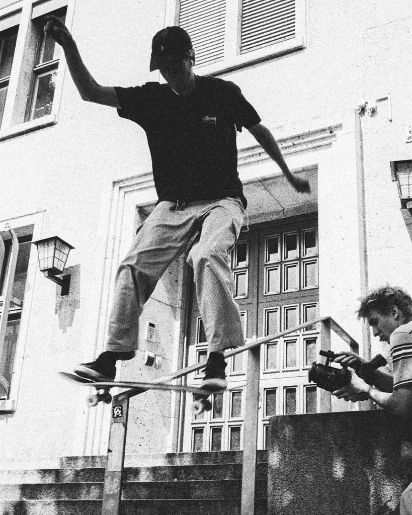 skater boardslide with a filmer